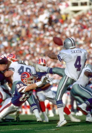 Tasker blocks a punt during Super Bowl XXVII. Photo by Tony Tomsic-USA  TODAY Sports f8b8819c8