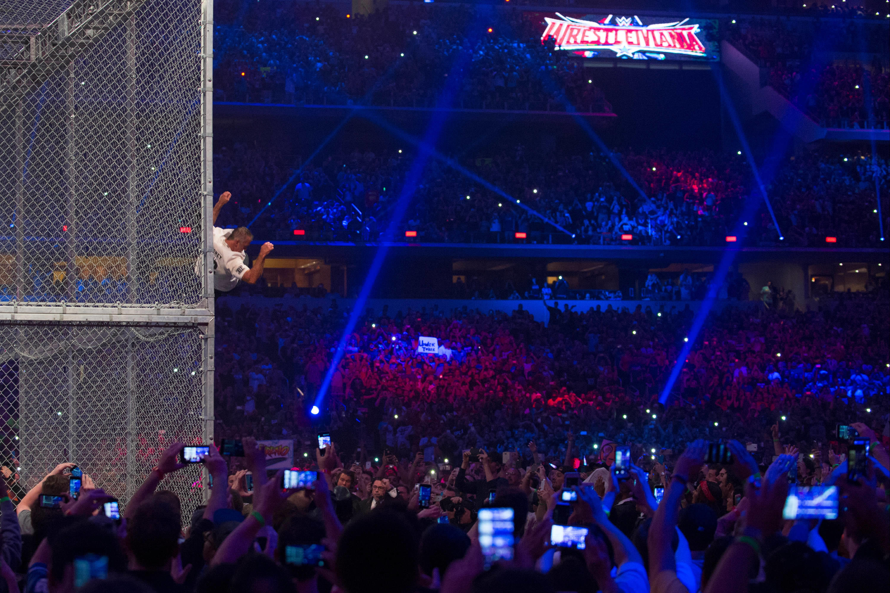 Wwe announces 2q14 earnings wwe network subscriptions youtube - Shane Mcmahon Launches Himself Off The Top Of A Steel Cage During His Match Against The Undertaker At Wrestlemania 32 Photo By Cooper Neill