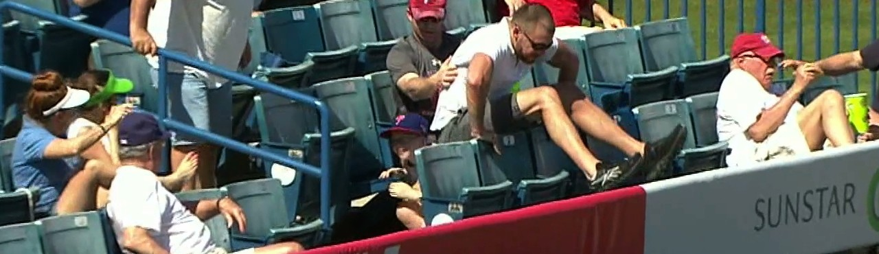 Man Jumps on Small Child to Avoid Foul Ball