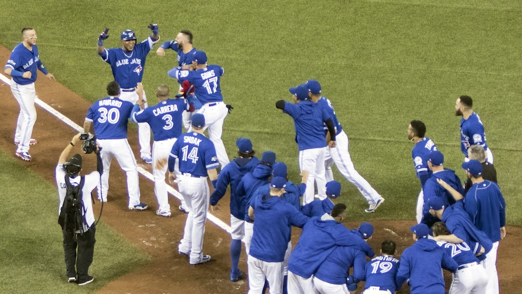 The Epic AL Wild-Card Game in Photos: Toronto's Day Started and Ended with a Smile