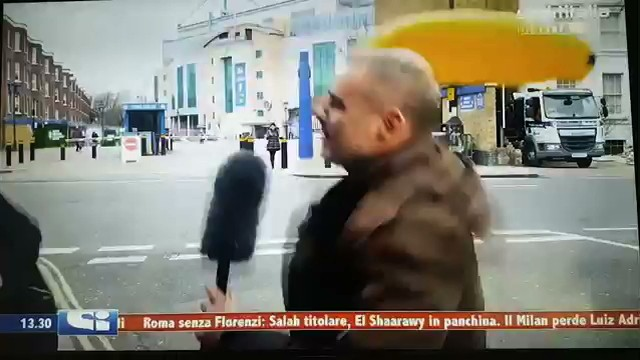 Italian Reporter Has Enough of Dude Brandishing Banana in His Face, Beats Him With It