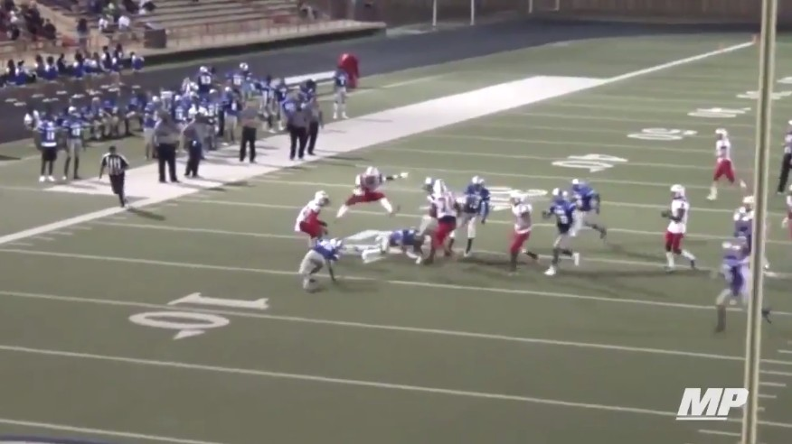 High School RB Ta'Zhawn Henry Vaults Over Two Defenders In a Single Bound