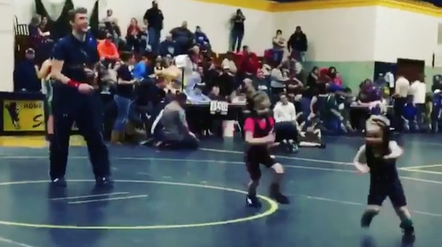 Tiny Boy Wrestler Runs Away from Less Tiny Girl Wrestler in Good Show of Instincts